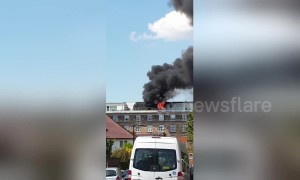 Thick smoke envelops London block of flats in east Acton