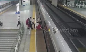 Chinese woman uses foot to prevent train from departing after arriving late to the station