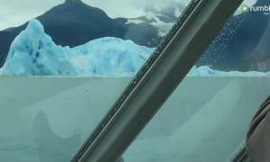 Incredible footage captures massive iceberg flipping over