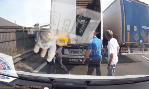 Truck on UK motorway stops to unload migrant workers