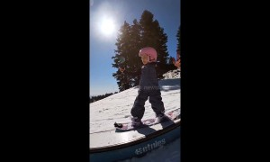Three-year-old snowboarder takes on the slopes