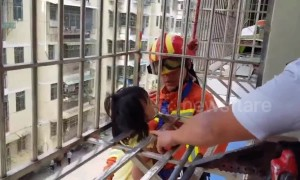Firefighters rescue girl hanging from fourth-floor window in China's Ganzhou