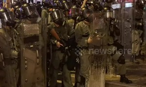 Closeup footage shows Hong Kong riot police firing tear gas towards protesters