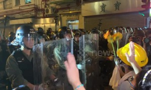 Protesters attempt to give flowers to riot police before attempt to clear streets