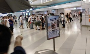 Protesters use water hose to defend themselves against marauding gang at Hong Kong station