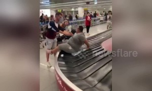 Man shoves larger friend into doing 'baggage claim surfing'