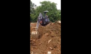 Big boy's toys! Vietnamese seven-year-old learns to drive excavator to help his father