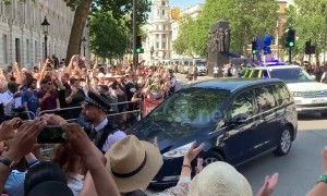 Boris Johnson greeted by a mix of cheers and jeers at Downing Street after being announced as Prime Minister