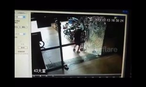 Glass door suddenly shatters as woman tries to open it in China's Foshan