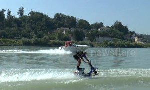 Austrian stuntman demonstrates extreme Vespa waterskiing