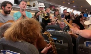 Passengers stranded on Heathrow flight dance to band during four hour wait