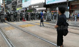 Standoff between police and protesters in Hong Kong's Yuen Long district