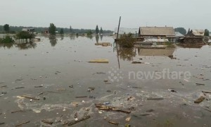 Flooding in southern Russia's Irkutsk sees hundreds of homes wrecked