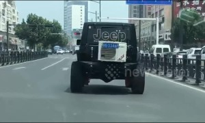 Jeep has air conditioning unit attached to its boot while driving on Chinese road