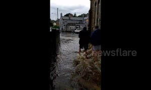 Leyburn residents wade through floodwater after heavy downpours hit North Yorkshire