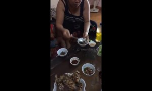 A group of Vietnamese people eat fish - while they are still alive!