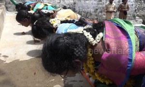 Indian women eat from the floor with hands behind back in bizarre fertility ritual