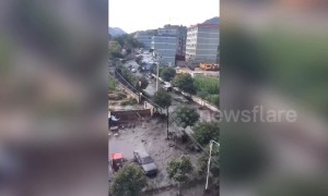 Coal factory and streets submerged after nearby dam collapses in northern China