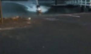 Jet Ski Slides Along Car Park