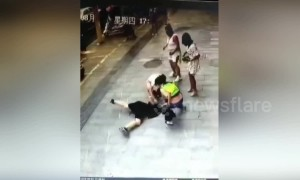 Chinese dad rescues son after he falls through broken manhole cover