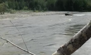 Boat Jumps River Blockage