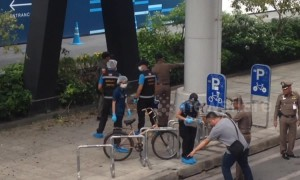 Police and forensics teams at scene of BTS Chong Nonsi station bomb