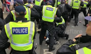 Tommy Robinson supporters clash with police in central London