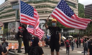 Protesters in Hong Kong seen waving US flags