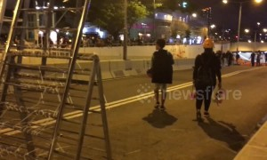 Protestors block main road in Kowloon, Hong Kong