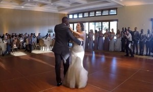 Bride and groom surprise guests with mashup wedding dance