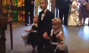 Flower girl's priceless reaction after seeing dad down the aisle