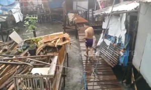Tropical storm batters coastal homes in the Philippines