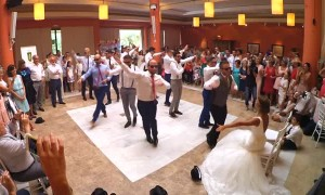 Bride surprised with dance led by groom and his groomsmen