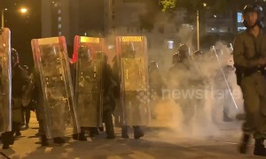 Masked youths in Hong Kong throw bricks and glass bottles at riot police