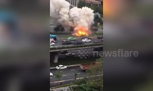Smoke pours out of van after it explodes on road in China's Chengdu