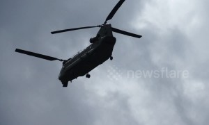 RAF helicopters continue to fly in emergency supplies to help reinforce the Whaley Bridge dam