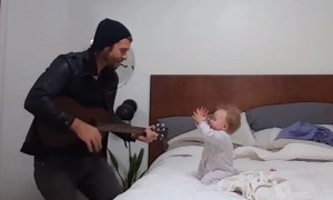 When dad begins to play guitar, this baby has the best reaction ever