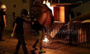 Hong Kong protestors start fire at police station as fire department rushes to extinguish it