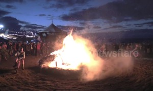 Spectacular footage of Spain's Motorbeach festival sees motorbikes ride around a huge bonfire