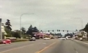 Police car dash cam captures airplane landing on Washington road