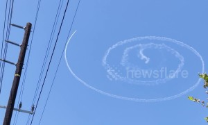 Jet impressively draws perfect spiral in skies over Los Angeles
