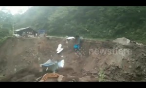 Portacabin and truck fall into river during massive mudslide in China