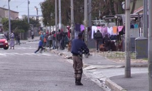 Cape Town law enforcement officers fire upon protesters as the city is in lockdown