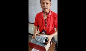 Filipino teacher breaks down in tears when pupils buy him a new pair of shoes