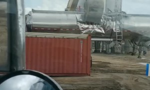 Excavator Trashes Trailer