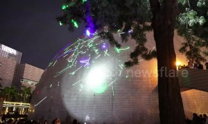 Hong Kong protestors perform laser light show to support student arrested for purchasing laser pen
