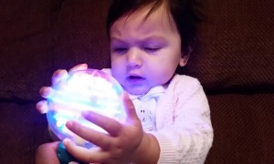 Baby is Amazed About Spinning Light Toy