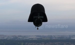 Hot air Darth Vader floats over Bristol's iconic Clifton Suspension Bridge as part of balloon fiesta