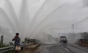 Burst water pipe drenches drivers in Thailand