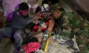 Cambodian man rescued after spending four days wedged between rocks in a cave